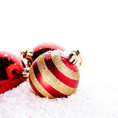 New Year's striped red balls on snow. — Stock Photo
