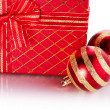 New Year's striped red balls and gift. — Stockfoto #54752803
