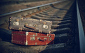 Old suitcases on rails — Stock Photo
