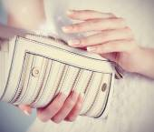 Female hands with manicure with white handbag — Stock Photo