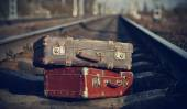 The image of vintage suitcases forgotten on railway tracks. — Stock Photo