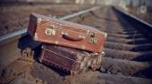 The image of vintage suitcases thrown on railway tracks. — Stock Photo