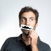 Funny guy with fake moustache — Stock Photo