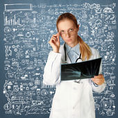 Doctor woman with x-ray picture — Stock Photo