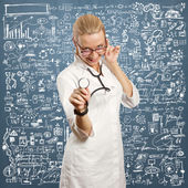 Young doctor woman with stethoscope — Stock Photo