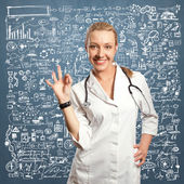 Young doctor woman shows ok — Stock Photo