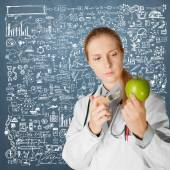 Scientist woman with apple — Stock Photo