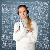 Doctor woman with headphones smile at camera — Stock Photo