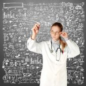 Doctor woman writting something — Stock Photo