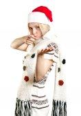 Vrouw in kerstmuts met open hand — Stockfoto