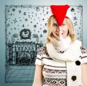 Blonde vrouw in de Kerstman hoed — Stockfoto