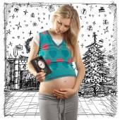 Kobieta w ciąży czeka na prezent na Boże Narodzenie — Zdjęcie stockowe