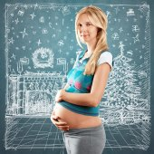 Pregnant with christmas gift — Stock Photo