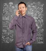 Asian man smiling talking on the cell — Stock Photo