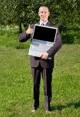 Businessman gesturing thumb up — Stock Photo