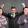Asian team and businessman with hands up — Stock Photo #69086687
