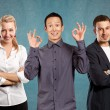 Teamwork and Asian Man shows OK — Stock Photo #70789651