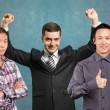 Asian team and businessman with hands up — Stock Photo #71408681