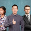 Asian team and male in suit — Stock Photo #71408793