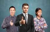 Team of business people   shows well done — Stock Photo