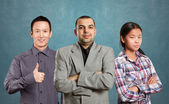 Asian team and male in suit — Stock Photo