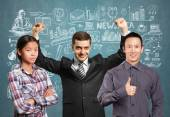 Asian team and businessman with hands up — Stock Photo