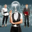 Lamp head businesswoman and business team — Stock Photo #78416694