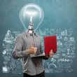 Lamp head man with laptop and thumb up — Stock Photo #78416724