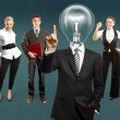 Lamp head businessman and business team — Stock Photo #78416844
