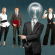 Lamp head businessman and business team — Stock Photo #78416918