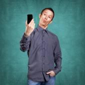 Asian man making selfie — Stock Photo