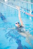 Girl in swimming back crawl stroke style — Stock Photo