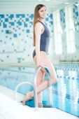 Young woman in sport swimming pool — Stock Photo