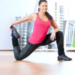 Woman doing stretching exercises at gym — Stock Photo #52935295