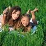 Happy girls on green grass — Stock Photo #52935711