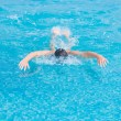 Girl swimming butterfly stroke style — Stockfoto #52938345