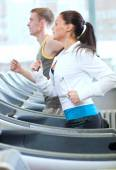 Woman and man exercising at gym — Foto de Stock