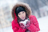 Young woman plays with a snow — Stock Photo