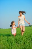 Girls running at green wheat field — Stock Photo