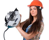 Woman holding an electric circular disk saw. — Stockfoto