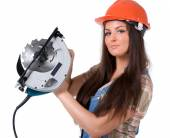 Woman holding an electric circular disk saw. — Stock Photo