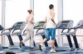 Woman and man at gym exercising. — Foto de Stock
