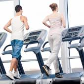 Woman and man at gym exercising. — Foto de Stock