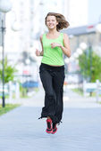 Woman jogging in city street park. — Stock Photo
