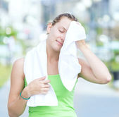 Tired woman after fitness time in city park — Stock Photo