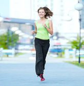 Woman jogging in city street park. — Stok fotoğraf