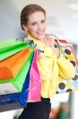 Woman with shopping bags in mall — Stock Photo