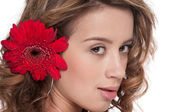Beautiful girl with red aster flower — Stock Photo