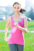 Woman running in city park — Stock Photo