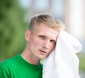 Tired man after fitness time and exercising. With white towel — Stock Photo
